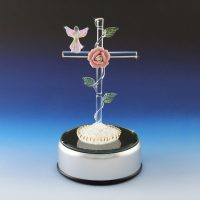 glass cross with angel figurine